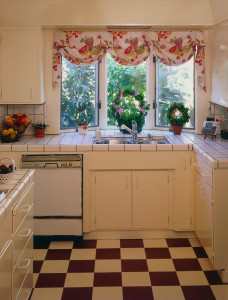 White on White cabinetry, custom balloon and swag window treatment, black and white checkerboard flooring.
