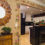 Hand painted floral vine, artisan painted cabinet, shell starburst mirror.