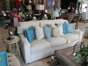 Creme chenille sofa with turquoise down filled accent pillows. OA dimensions 86 x 44 Priced at just $3499.00