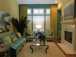 Transitional interior design with elegant furniture is created by beautiful turquoise and gold living room space
