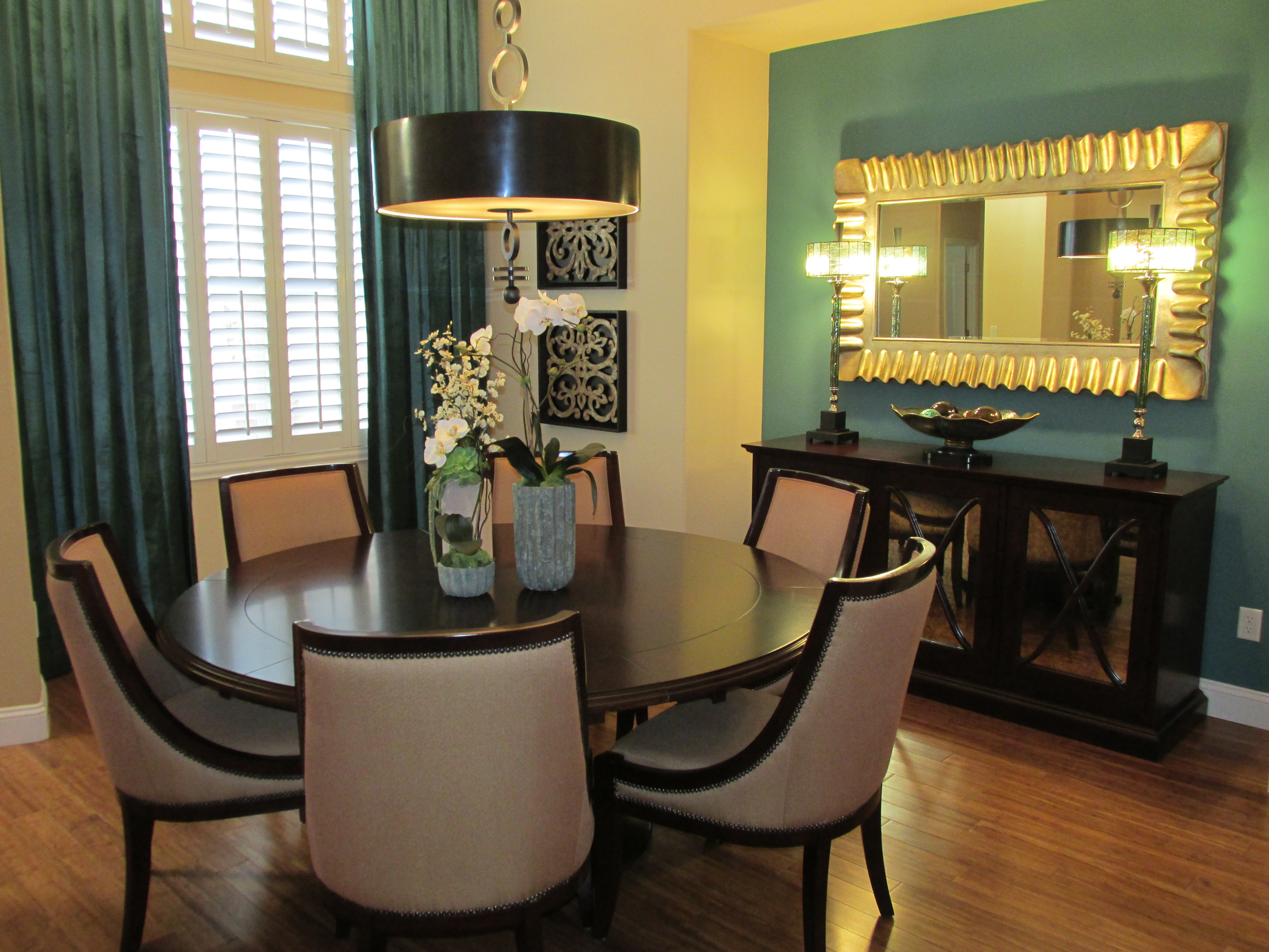 Dining Space With Gold And Turquoise Accents Create An Elegant Interior  Design Using Transitional Furniture.