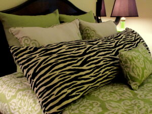 Zebra print with lime damask bedding ensamble.