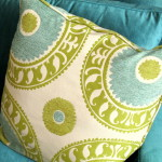 Turquoise and gold fabric accent pillows for sofa.