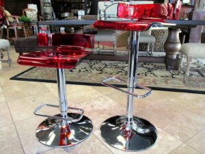 "Contemporary red Lucite bar and chrome bar stools. Seats swivel and stool adjusts to any height needed. 16"" square . Just $195.00 each"