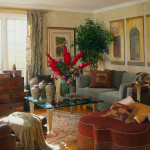 Hand textured walls, moroccan star ottoman, teak trunk console table, custom floral arrangement, crinkle sheer drapery panels.