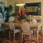 Hand textured walls, cameo back dining chairs crackle finish, over sized frame mirror, preserved palm foliage.