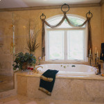 Hand textured walls and crown moulding, honed travertine tub and shower surround, iron swag drapery hardware..
