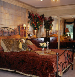 Hand Painted faux window wall mural, bronze frame bed, velvet damask bed ensemble, custom floral arrangement.