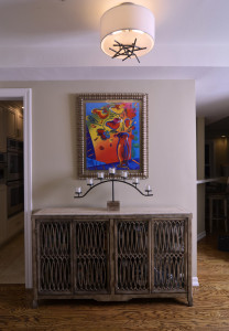 Modern art, organic front paneled console chest, Hubberton Forge stick flush mount ceiling fixture create a transitional interior design with transitional furniture.