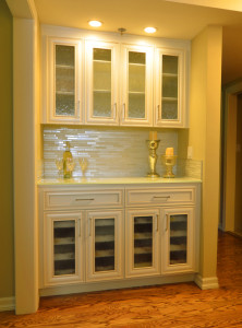 Custom glass tile backsplash, custom seeded glass cabinetry, transitional interior design.