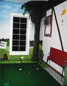 """Hand painted """"Caddy Shack"""" themed mural around a mini-golf putting green. Themed interior design"""