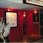"""Morphious Cinema"" custom designed marquis, Grauman's Chinese Theater entry with families hand prints in the concrete, theater style seating and Arte Deco lighting and wall coverings. Themed interior design"