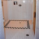 Chicago White Sox themed bath with entrance from vanity area or off of the gym, shower with custom telework, duel overhead shower heads, sauna, dual urinals, storage lockers. Themed interior design