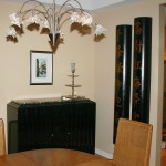 "Asian ""Longevity"" pillars, black lacquer scalloped front sideboard with marble top from Vienna, wire mesh shade chandeliers. (Customers own table and chairs). Asian contemporary Interior design"