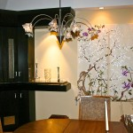 Hand Painted Asian screen wall hanging on custom brackets, Custom built-in cabinetry with wire glass cut outs, coordinating marble counter top, wire mesh shade chandeliers. (Customers own table and chairs) Asian contemporary interior design
