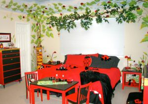 "Custom ""Lady Bug on Vine"" mural with twig window valance, hand painted lady bug inspired furniture, accessories and bedding. Interior design"