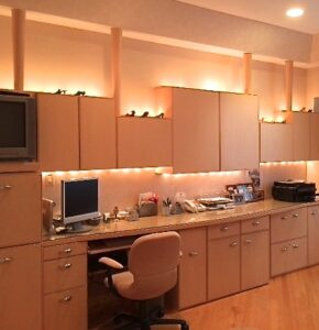 Custom office cabinetry, perimeter routed flat front doors, floating upper cabinets with up and under-cabinet lighting, pullout printer drawers, bowed front countertop, hand textured tray ceiling, Ultra Suede desk chair. Contemporary elegant interior design