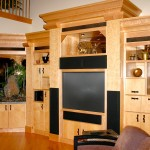 Solid Maple and Birdseye maple custom wall unit, multi tiered crown moulding, bronze mirrored pack panels, chain screen light box details, lava rock waterfall. Asian Contemporary interior design.