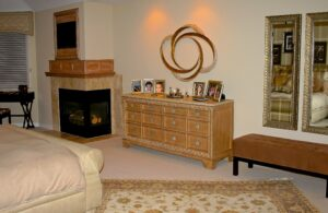 Custom fireplace mantel and TV surround, Asian Inspired cross reed edged dresser, was art, tufted box bench, twin mirrors, silk hand knotted area rugs,
